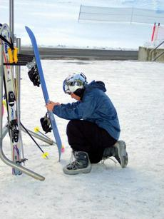 for Travel - 05college - Skier adjusts gear at the Dartmouth Skiway. (David Lyon for the Boston Globe)
